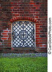 Window in the old brick wall