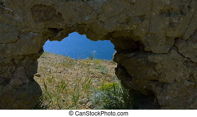 Window in the rock - A hole in the masonry and a view of the...