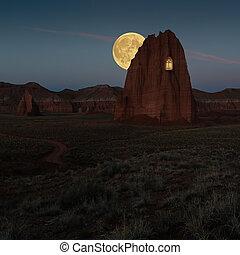 Window in the rock in Monument Valley - Hunts mesa in...