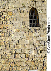 Window in the wall of the old tower