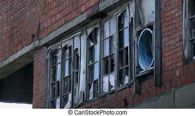 Window of abandoned red building