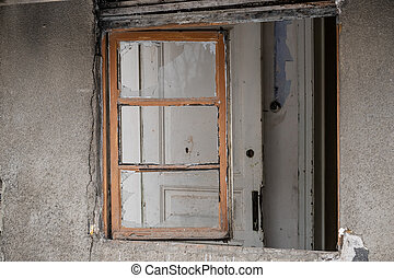 Window of an empty abandoned old building with broken ...