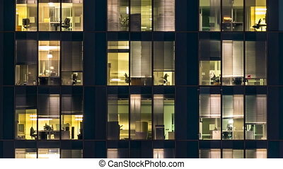 window of the multi-storey building of glass and steel...
