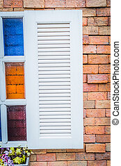 Window on a brick wall.