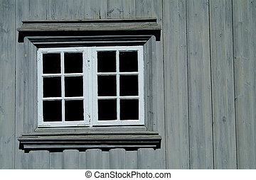 Window on a gray wall