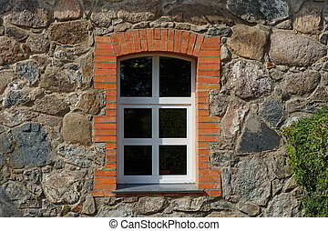 Window on a stone wall.