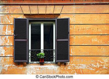 Window on an old facade