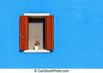 Window on blue wall in Burano, Italy.