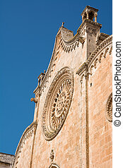 Window on facade of the cathedral of Ostuni (Italy)