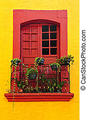 Window on Mexican house - Red painted window with plants and...