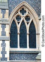 Window on old catholic church in Lo