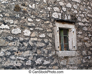 Window on old stone house