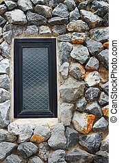 Window on the stone wall