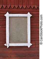 Window on wooden wall