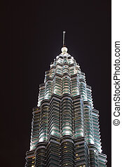 Window Pattern of Single Illuminated Petronas Tower in Night Sky Kuala Lumpur Malaysia