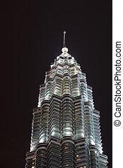 Window Pattern of Single Illuminated Petronas Tower in Night Sky Kuala Lumpur Malaysia