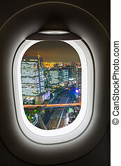 Window plane with view of cityscape