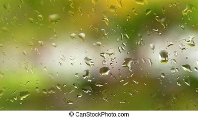 Window raindrops slow motion - Focused raindrops on a window...