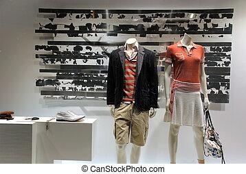 Boutique in paris, pret a porter fashion in store window.