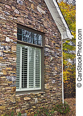 Window Shutters and Stone Facade