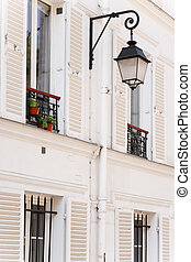 Window shutters - Traditional houses with shutters on the...