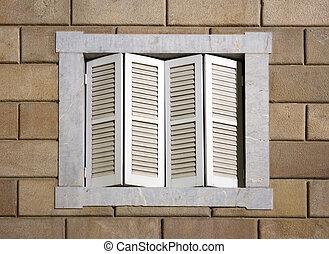 Window shutters - White closed window shutters at night