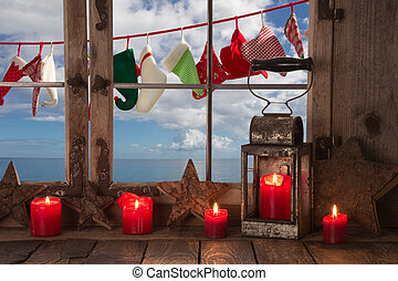 Window-sill decorated with red christmas candles: view to...