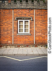 Window - A window in a red brick wall in an english building