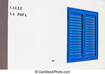 Window - Blue window on the white wall. Lanzarote, Canarian...