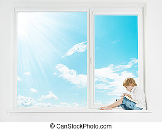 Window sunshine sky. Child reading book.