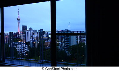 Window view Auckland city skyline - Panning motion on a big ...