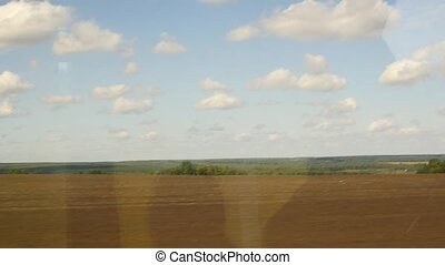 Window view from bus on a autumn fields. slow motion -...