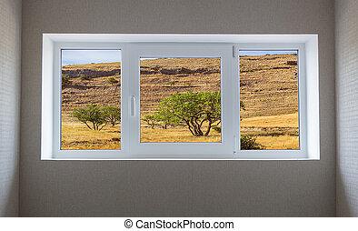 Window view of a beautiful mountain landscape