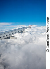 Window view of the wing of an airplane