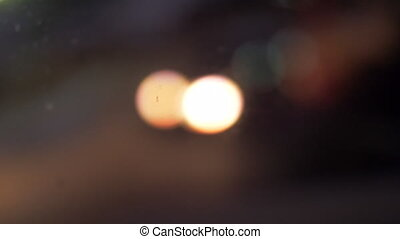 Window view to the lantern and cars with headlights, defocus...