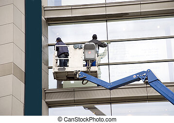 window washers on a hydraulic ramp