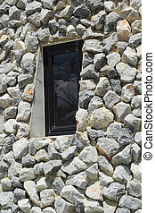 Window with a rock.