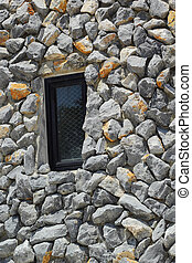 Window with a rock