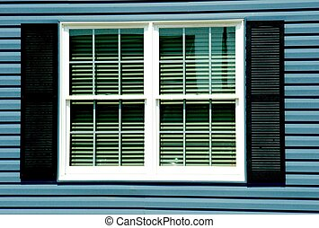 WINDOW WITH BLACK SHUTTERS