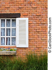 Window with brick wall red.
