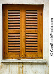 Window with closed wooden shutters.