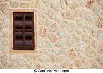 Window with closed wooden shutters