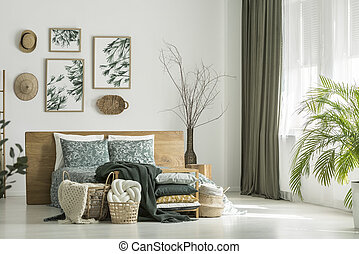 Window with khaki curtain - White room with floral bedding...