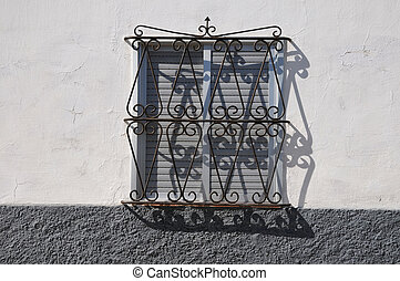 window with metal grate
