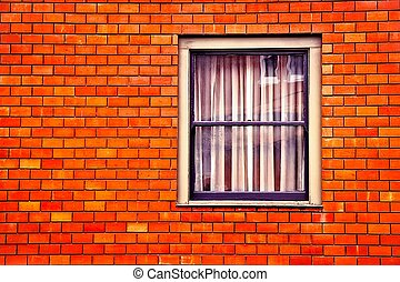 window with old orange brick wall