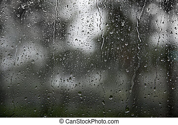 Window with raindrops - window with raindrops duing heavy...