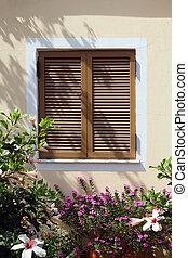 window with shutter in beautiful flowers- Crete, Greece
