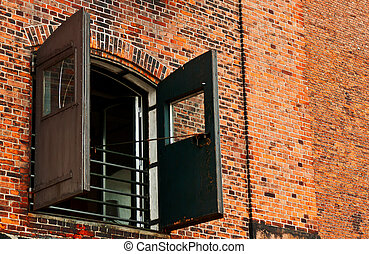 Window with shutters on brick background