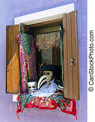 Window with Venetian carnival accessories