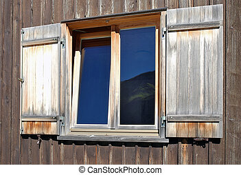 window with wood shutters